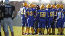 Students at Sir Robert L. Borden high school talk to a coach during a football game against Lester B. Pearson C.I. in Scarborough. (Peter Power/The Globe and Mail/Peter Power/The Globe and Mail)