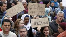 Protesters in Montreal gathered this weekend to rally against a proposed ban on relgious garb. (CHRISTINNE MUSCHI/REUTERS)