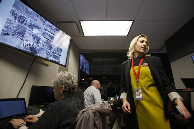 Rogers Place vice president and general manager Susan Darrington, right, keeps an eye on all situations in the arena's venue command centre before an Edmonton Oilers pre-season game in Edmonton, Alta., on Tuesday, Oct. 4, 2016.