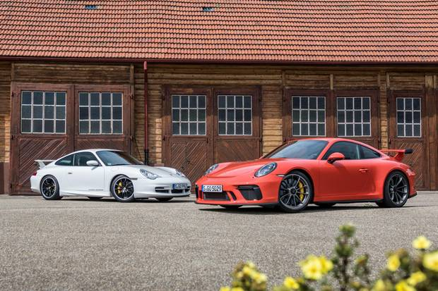 A 2002 GT3 (left), sourced from the Porsche Museum, offers an interesting comparison with the latest edition.