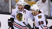 Chicago Blackhawks' Jonathan Toews celebrates his goal on the Boston Bruins with teammate Patrick Kane during the second period in Game 6 of their NHL Stanley Cup Finals hockey series in Boston, Mass., June 24, 2013 (Reuters)