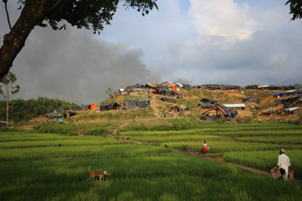 Smoke from burning Rohingya homes rises into the air from Myanmar, as seen from Bangladesh on Thursday, Sept. 14, 2017.