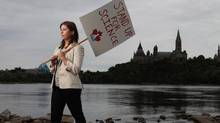"Dr. Katie Gibbs of Evidence for Democracy along the Ottawa River September 15, 2013 in Ottawa. ""Stand up for Science"" is planning rallies in cities across the country to advocate for Canadian research. (Dave Chan FOR THE GLOBE AND MAIL)"