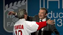 1972 Team Canada's Paul Henderson is greeted by 1972 Soviet team's goalkeeper Vladislav Tretiak as he is inducted at the IIHF Hall of Fame at the world hockey championship in Stockholm Sweden on Sunday, May 19, 2013. (Jacques Boissinot/THE CANADIAN PRESS)