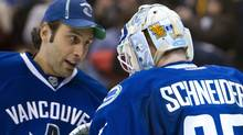 Goalie Roberto Luongo #1 of the Vancouver Canucks congratulates goalie Cory Schneider #35 after defeating the Columbus Blue Jackets in NHL action on November 29, 2011 at Rogers Arena in Vancouver, British Columbia, Canada. (Photo by Rich Lam/Getty Images) (Rich Lam/Getty Images)