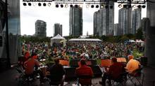 Ray Piper, far right, and Gostosinho perform on a free outdoor stage at David Lam Park during the Vancouver International Jazz Festival in Vancouver on Saturday July 3, 2010. (Darryl Dyck For The Globe and Mail)