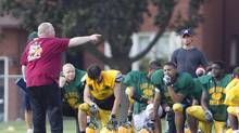 Toronto Mayor Rob Ford coaches the Don Bosco Eagles on Sept. 11, 2012, with his city hall assistant Andrew Gillis, at right in blue shirt. (Peter Power/The Globe and Mail)