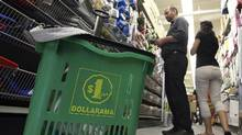 File photo of customers shopping in a Dollarama store in Toronto. (Deborah Baic/The Globe and Mail)