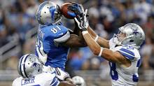 Detroit Lions wide receiver Calvin Johnson (81) pulls in a 54-yard reception as Dallas Cowboys cornerback Brandon Carr (39) and Dallas Cowboys defensive back Jeff Heath (38) defends in the fourth quarter of an NFL football game in Detroit, Sunday, Oct. 27, 2013. (DUANE BURLESON/AP)