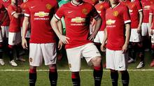 Robin van Persie, Wayne Rooney and Shinji Kagawa are shown wearing the 2014-2015 Manchester United shirt. (General Motors)