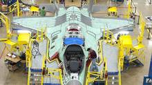 The moving line and forward fuselage assembly areas for the F-35 Joint Strike Fighter at Lockheed Martin's plant in Fort Worth, Tex. The Netherlands may cut 17 to 33 F-35s from its initial plans to buy 85 of the new warplanes, according to people close to the discussions. (REUTERS)