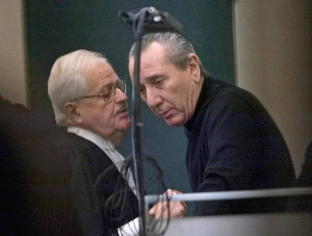 Vito Rizzuto (right) reputed head of the Montreal mafia, speaks with his attorney Jean Salois after his hearing in Montreal February, 2004. At the time, Mr. Rizzuto was facing extradition to the United States to face charges related to the murders of three mafia captains in New York in 1981.