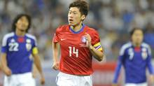 South Korea's midfielder Park Ji-Sung reacts after scoring his team's first goal against Japan during their international friendly football match at Saitama Stadium, suburban Tokyo, on Monday. (KAZUHIRO NOGI/AFP/Getty Images)