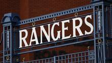 A Rangers name plate is seen above a gate at the Ibrox Stadium in Glasgow, Scotland February 13, 2012. Scottish soccer champions Rangers have given notice that they plan to go into administration after running into financial problems centred on a disputed tax bill. (DAVID MOIR/REUTERS)