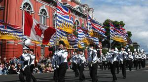 Members of the Chilliwack (BC) Middle School Chargers Marching Band carry the Canadian and British Columbia flags past old City Hall on Douglas Street in Victoria, B.C. in 2005.