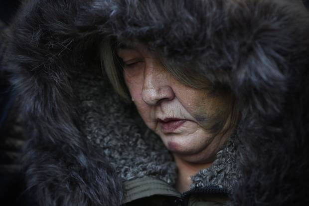 Tears roll downtime cheeks of Thelma Favel, Tina Fontaine's great-aunt and the woman who raised her