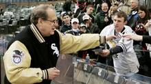 Chicago White Sox owner Jerry Reinsdorf signs autographs for fans before Game 1 of the World Series in Chicago on Oct. 22, 2005. (MARK J. TERRILL)