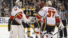 Calgary Flames goalie Miikka Kiprusoff, left, replaces goalie Leland Irving during the second period against the Boston Bruins (Charles Krupa/Associated Press/Charles Krupa/Associated Press)