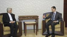 Syria's President Bashar al-Assad (R) meets Iran's Supreme National Security Council secretary Saeed Jalili, in Damascus August 7, 2012, in this handout photo distributed by Syrian News Agency (SANA). (SANA/REUTERS)
