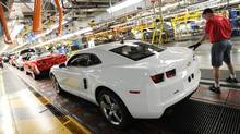 Workers on General Motors 'flex line' build automobiles in Oshawa, Ont. (Kevin Van Paassen/The Globe and Mail/Kevin Van Paassen/The Globe and Mail)