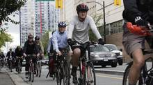 Cyclists use the Dunsmuir Street bike lane in Vancouver in 2010. Critics say the city is moving too quickly on the idea of adding more separated bike lanes to routes that go downtown (Lyle Stafford For The Globe and Mail)