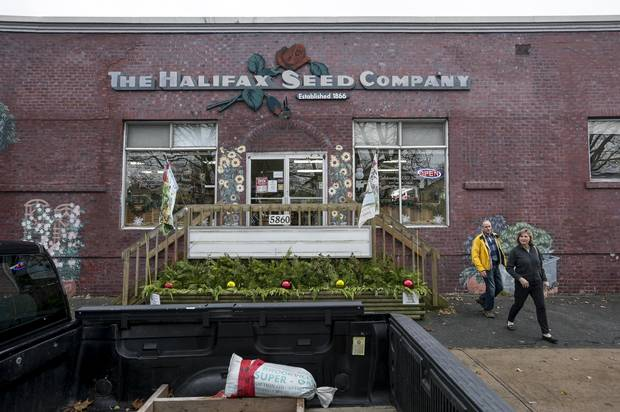 Shoppers leave The Halifax Seed Company Inc. on Dec. 1, 2017.