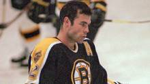 Boston Bruins Adam Oates takes a break during the Bruins training camp at Ristuccia Memorial Arena in Wilmington, Mass., Tuesday, Sept. 10, 1996. (C. J. Gunther/AP)