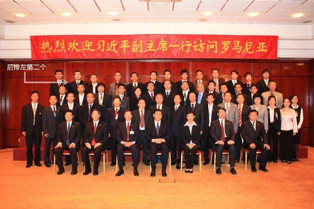 Wilson Wang (second from left in the back row, indicated with an arrow) has been detained, interrogated and tortured in China after being sentenced for bribery. This photo from 2009 – at a gathering in Romania with future Chinese president Xi Jinping, shown in the middle of the front row – contradicts key testimony in the case against him.