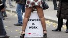A sex worker activist attends a demonstration with prostitutes against a proposal to scrap sanctions on soliciting and instead punish prostitutes' custo