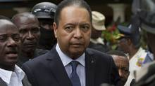 Haiti's ex-dictator Jean-Claude Duvalier is escorted out of his hotel in Port-au-Prince, Haiti, Tuesday Jan. 18, 2011. (Ramon Espinosa/AP)
