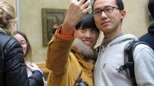 A couple creates their own masterpiece in the Louvre in front of The Mona Lisa. (Randall Moore/The Globe and Mail)