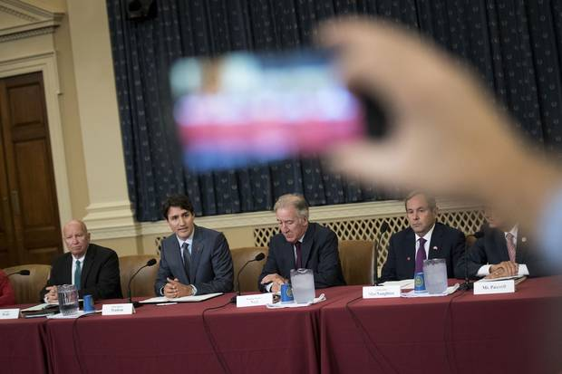 Republican congressman Kevin Brady, Mr. Trudeau, Democratic congressman Richard Neal and Canadian ambassador to the United States David MacNaughton attend a meeting with the House ways and Means committee.