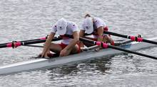 Canada's Lindsay Jennerich and Patricia Obee react after the women's lightweight double sculls semi-finals rowing event during the London 2012 Olympic Games at Eton Dorney August 2, 2012. (Reuters)