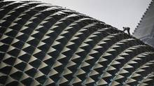 A worker perched on the roof of the Esplanade Theatre carries out the routine cleaning Wednesday, April 11, 2012 in Singapore. (AP Photo/Wong Maye-E) (Wong Maye-E/Wong Maye-E/AP)