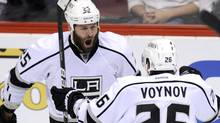 Los Angeles Kings left wing Dustin Penner (25) celebrates his game-winning goal in overtime over the Phoenix Coyotes with teammate Slava Voynov (26) during Game 5 of the NHL Western Conference hockey finals in Glendale, Ariz. (TODD KOROL/Reuters)