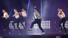 "South Korean pop singer PSY, in a checkered jacket, performs his new song ""Gentleman"" in his concert titled ""Happening"" in Seoul, South Korea Saturday, April 13, 2013. PSY's first new single since his megahit ""Gangnam Style"" was released in 119 countries on Friday, his agency said. (AP Photo/Kin Cheung) (Kin Cheung/AP)"