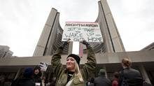 Protestors gather outside City Hall calling for the resignation of Toronto Mayor Rob Ford on Nov. 6, 2013. (MOE DOIRON/THE GLOBE AND MAIL)