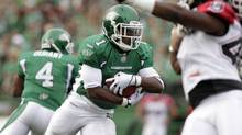 Saskatchewan Roughriders running back Kory Sheets runs up the ball while playing against Calgary Stampeders during the first half of their CFL football game in Regina, Saskatchewan, July 5, 2013. (DAVID STOBBE/REUTERS)