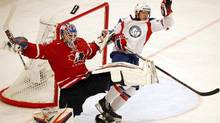 Norway's Ken Andre Olimb challenges Canada's goalie Devan Dubnyk during their 2013 IIHF Ice Hockey World Championship preliminary round match at the Globe Arena in Stockholm May 7, 2013. (ARND WIEGMANN/REUTERS)