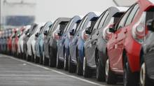 Newly produced Toyota cars are seen parked at Sendai port in Sendai, Miyagi prefecture, northeastern Japan March 2, 2012. (YURIKO NAKAO/REUTERS)