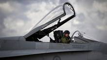 Pilot and Captain Mark Remington climbs out of his CF-18 in CFB Cold Lake. (John Lehmann/The Globe and Mail/John Lehmann/The Globe and Mail)