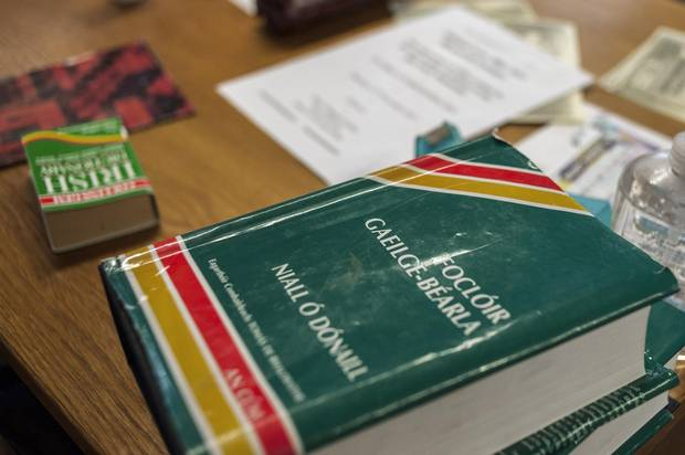 Irish dictionaries are seen on top of a table in a Turas classroom.