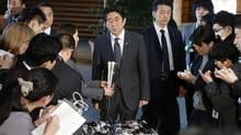 Japanese Prime Minister Shinzo Abe speaks to the reporters after meeting with Finance Minister Taro Aso, Economics Minister Akira Amari and Bank of Japan Gov. Masaaki Shirakawa, at the prime minister's official residence in Tokyo, Tuesday, Jan. 22, 2013. (Koji Sasahara/AP)