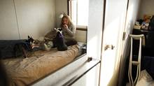 Eleanor Robertson is shown in her one-room temporary housing in Saddlebrook, near High River, Alta., on Oct. 30, 2013. (TODD KOROL FOR THE GLOBE AND MAIL)