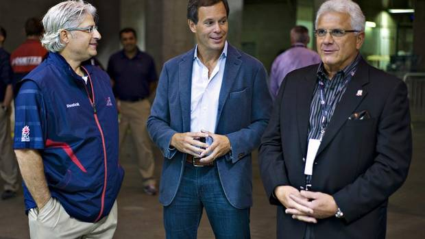 Canadian Football League Commissioner Mark Cohon (C) talks with Montreal Alouettes head coach Jim Popp (L) and BC Lions General Manager Wally Buono prior to their football game in Vancouver, British Columbia September 15, 2013. (ANDY CLARK/REUTERS)