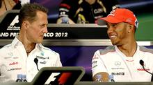 This May, 2012 file photo shows Mercedes Grand Prix driver Michael Schumacher of Germany, left, and McLaren Mercedes driver Lewis Hamilton of Britain during a news conference at the Monaco racetrack. Seven-time world champion Michael Schumacher is going to leave Mercedes at the end of the season, to be replaced by Lewis Hamilton. (Luca Bruno/AP Photo)