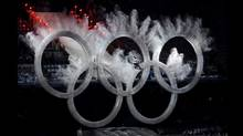 Feb. 12, 2010: A snowboarder flies through the Olympic rings during the opening ceremonies of the Vancouver 2010 Winter Olympics. (Fred Lum/Fred Lum/The Globe and Mail)