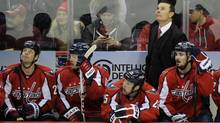 Washington Capitals head coach Adam Oates and the Capitals bench (Nick Wass/The Associated Press)