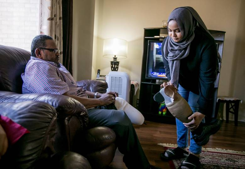 Hana Hussein, 20, helps out her father, who lost his legs as a result of diabetes. She has no regrets being a young caregiver. 'I knew things that most nine-year-olds wouldn't know, like what insulin is and how to inject it. It's made me more mature.""