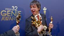 Philippe Falardeau, director of Monsieur Lazhar, reacts as he is handed his sixth award to hold at the 32nd Genie Awards in Toronto on March 8, 2012. (Chris Young/The Canadian Press/Chris Young/The Canadian Press)